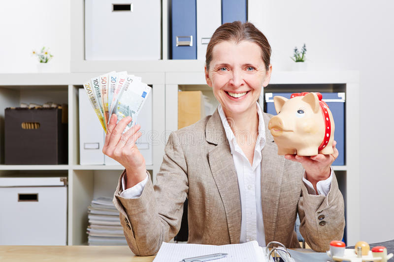 Woman with piggy bank and Euro stock images