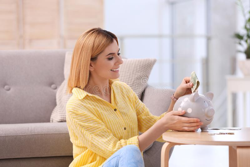 Woman with piggy bank and money stock photos