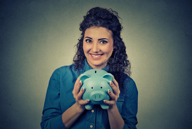 Woman with piggy bank. Young woman with piggy bank royalty free stock photos