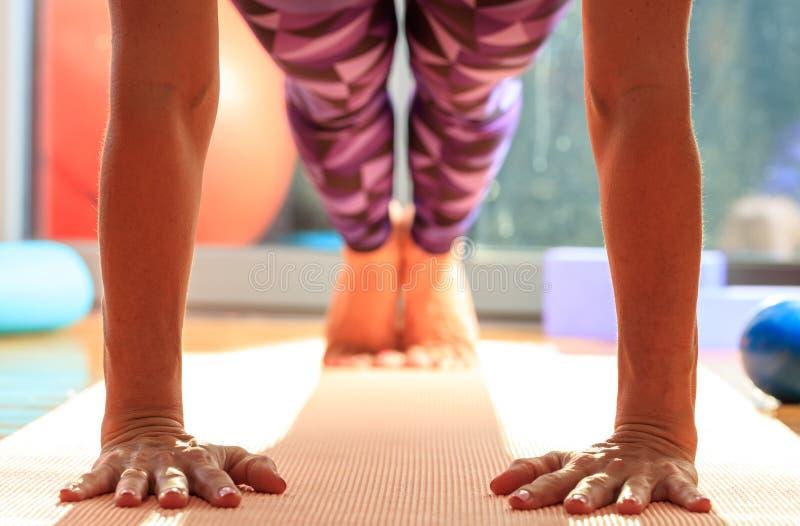 Woman in a pilates class, doing pushups stock photography