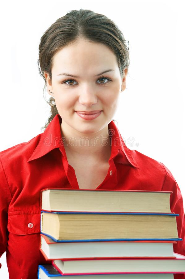 Woman with pile books royalty free stock photography