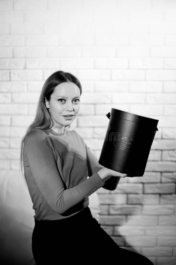 Woman with pile of presents at home. Woman with pile of presents at studio stock images