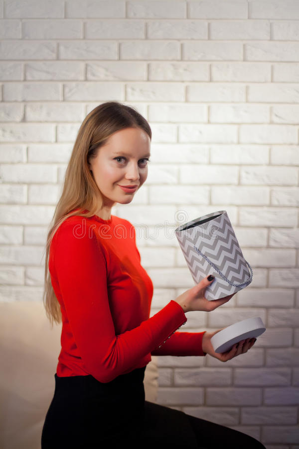 Woman with pile of presents at home. Woman with pile of presents at studio royalty free stock image