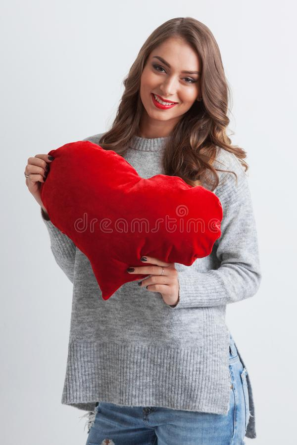 Woman with pillow heart stock image