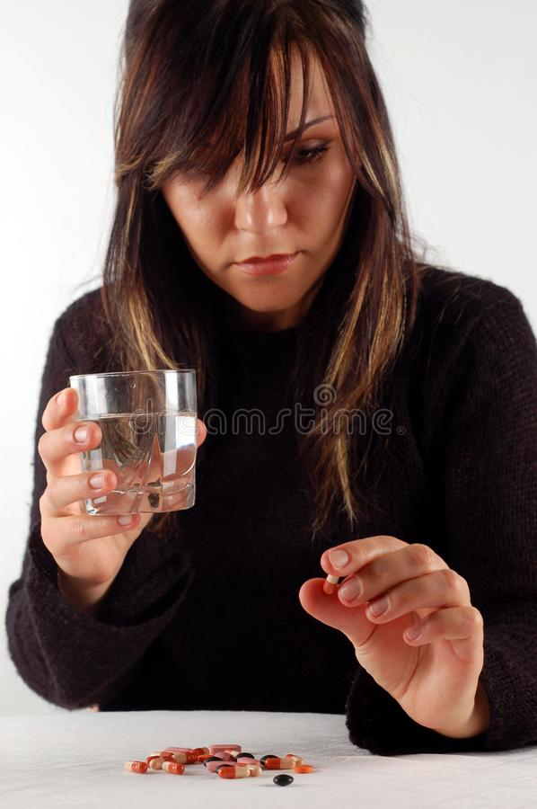 Woman with pills #4 stock images