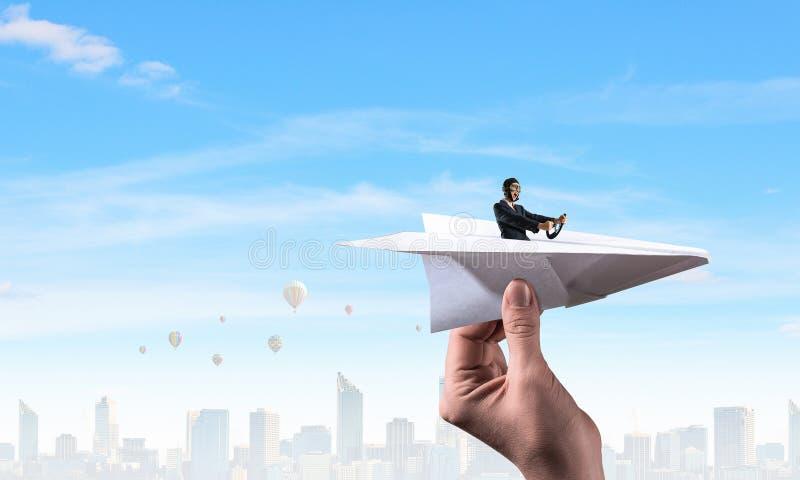 Woman pilot in paper plane. Mixed media. Woman Aviator floating in paper plane. Mixed media stock images