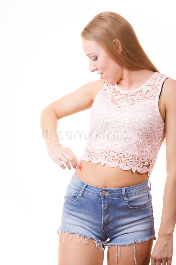 Woman pinching fat skin. Skinny woman holding pinching fat body hip stomach. Overweight cellulitis problem, weight loss concept, isolated on white royalty free stock image