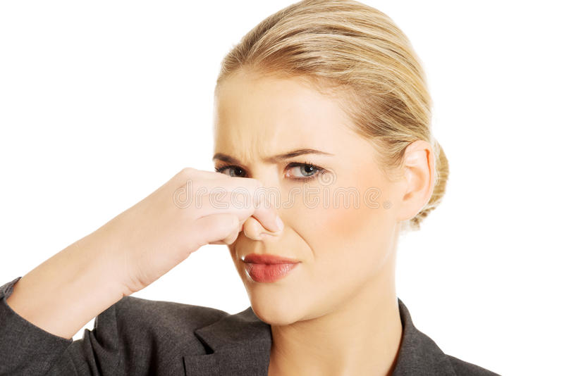 Woman pinching her nose. Because of disgusting smell royalty free stock image