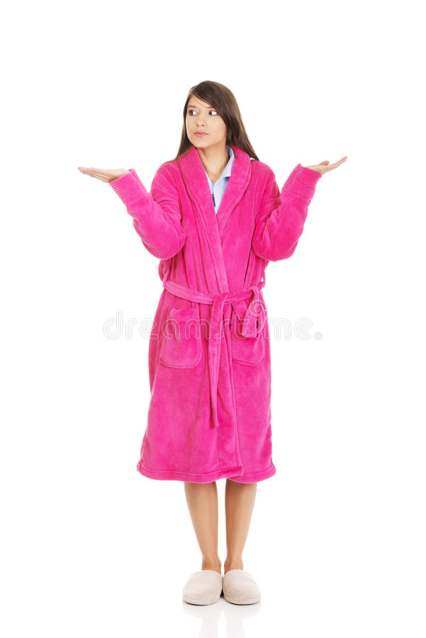 Woman in pink bathrobe showing empty palms. royalty free stock photos
