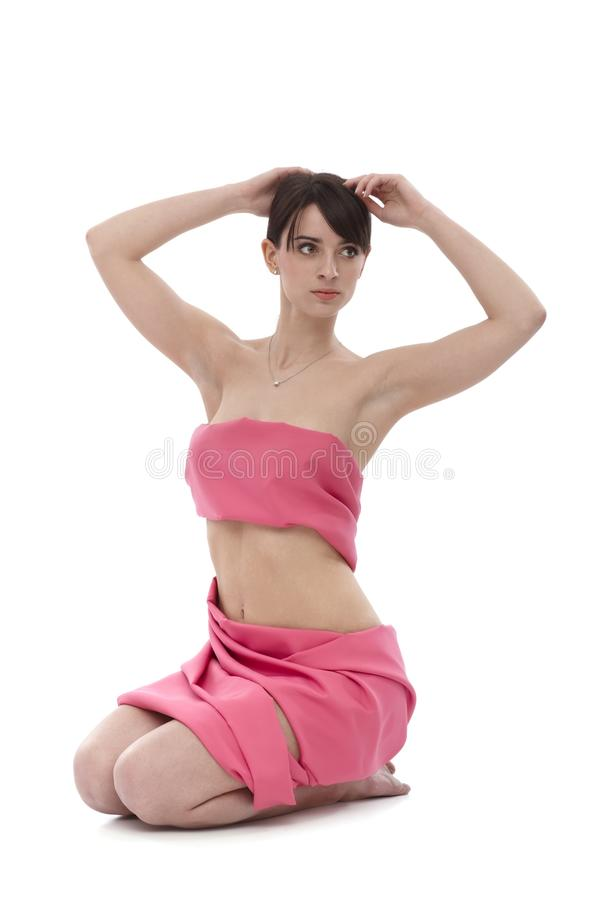 Woman in pink - Breast Cancer Awereness. Young woman wrapped into pink textile. This is a free image, part of a charity project. Models and the staff worked for royalty free stock photos