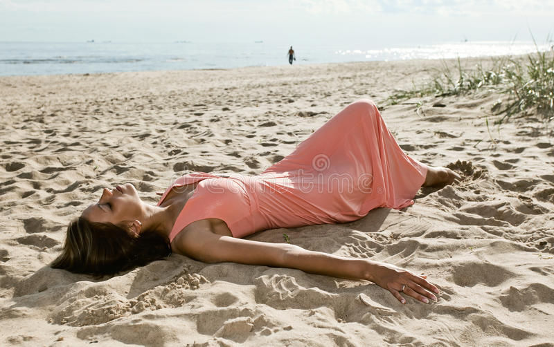 Download Woman In Pink Dress On Seacoast Stock Image - Image: 25966585