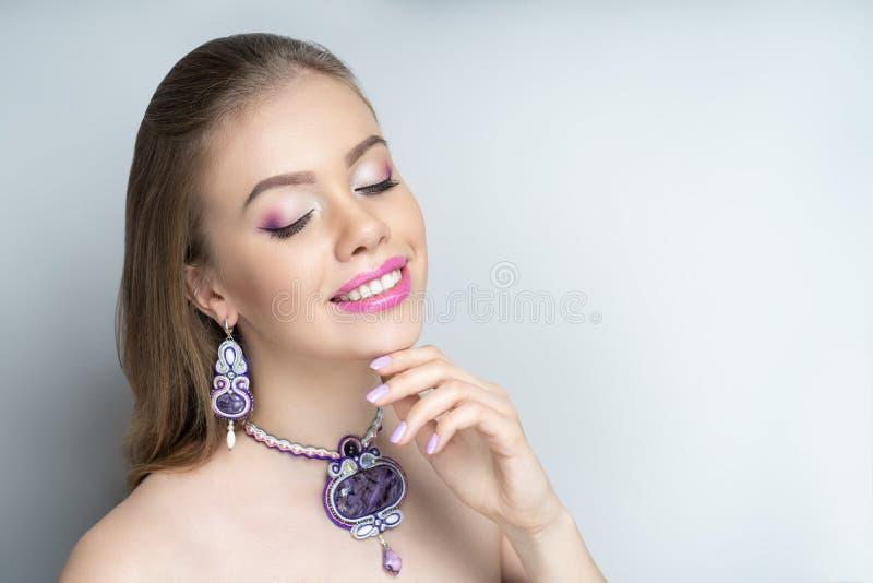 Woman pink eyeshadows stock photos