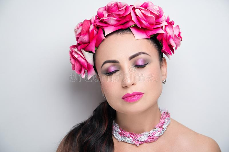 Woman pink flower wreath bright make up stock images