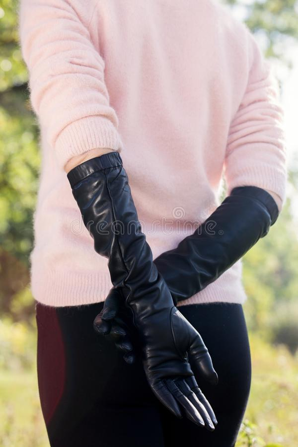 Long gloves stands back, Woman back royalty free stock images