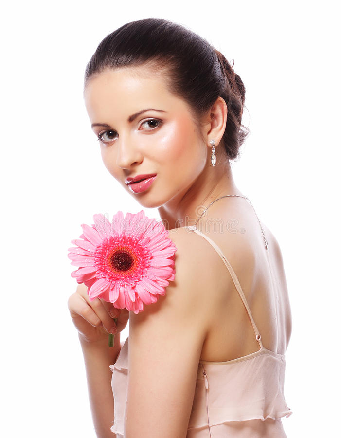 Woman with pink gerber flower isolated on white stock photos
