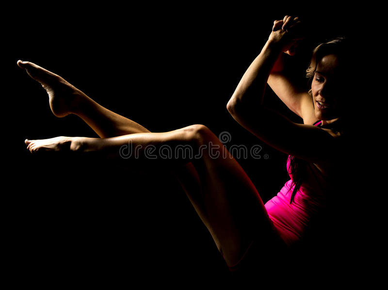 Woman in pink hightlighted legs and hands up royalty free stock photos