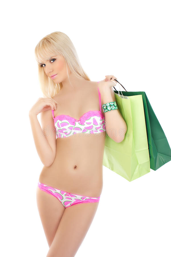 Download Woman In Pink Lingerie Holding Shopping Bags Stock Image - Image: 25036653