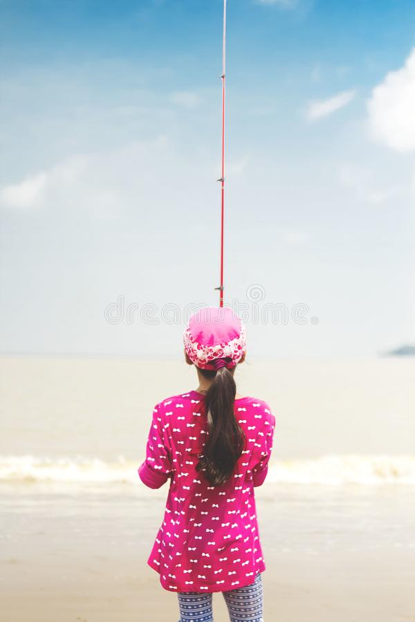Woman in Pink Long-sleeved Shirt Holding Red Fishing Rod royalty free stock images