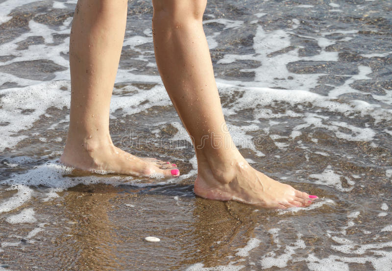 Download Woman With Pink Nailpolish Walking On The Beach Stock Image - Image of mediterranean, foam: 27497659