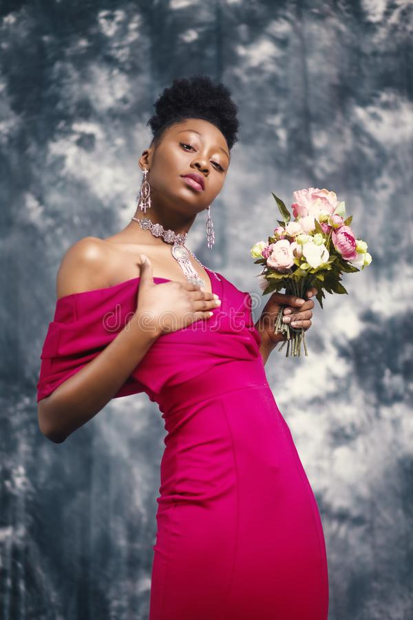 Woman in Pink Off-shoulder Dress Holding Pink and White Flower Bouquet stock image