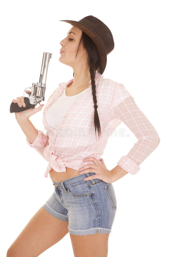 Woman pink plaid shirt gun blow stock images