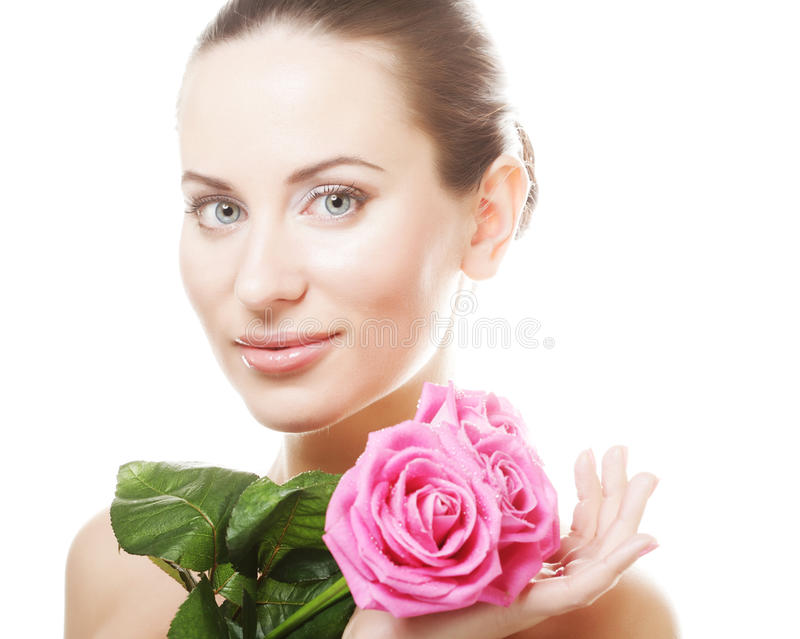 Woman with pink roses. Isolated on white stock image
