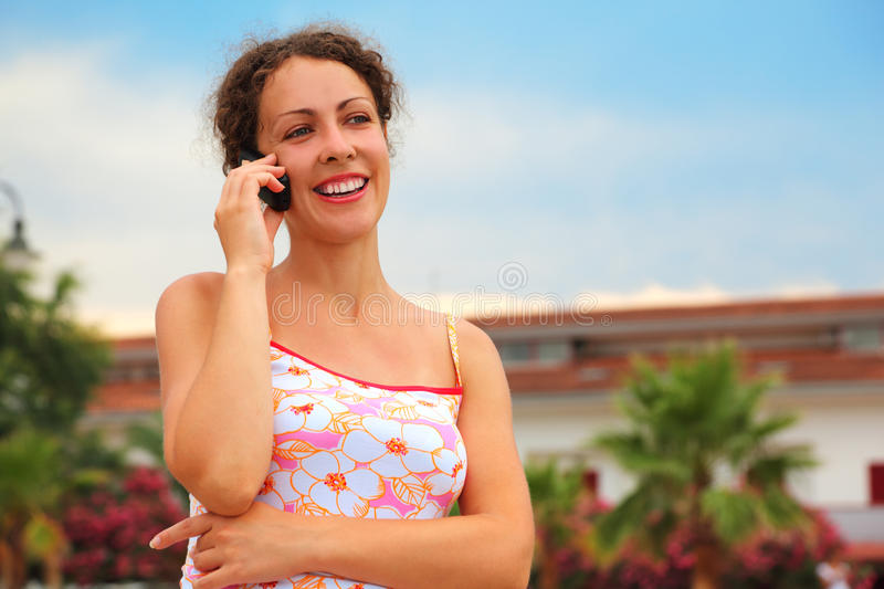 Download Woman In Pink Shirt Talking On Cell Phone Stock Photo - Image: 17888852
