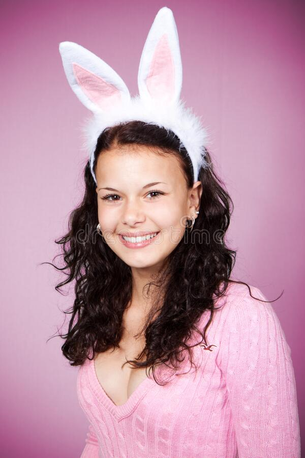 Woman In Pink Sweater Wearing Bunny Headband Smiling Against Pink Background Free Public Domain Cc0 Image