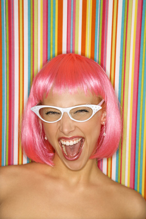 Download Woman in pink wig. stock photo. Image of studio, stripes - 2424606