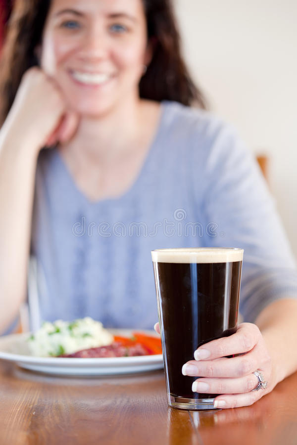 Woman With Pint Stock Photo