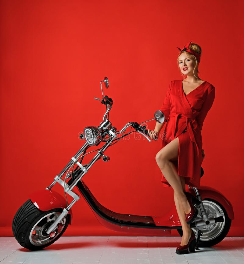 Woman pinup style ride new electric car motorcycle bicycle scooter present for new year 2019 stock photos