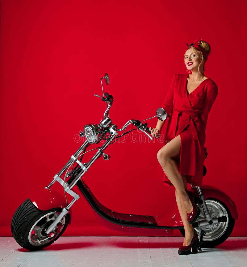 Woman pinup style ride new electric car motorcycle bicycle scooter present for new year 2019 stock images