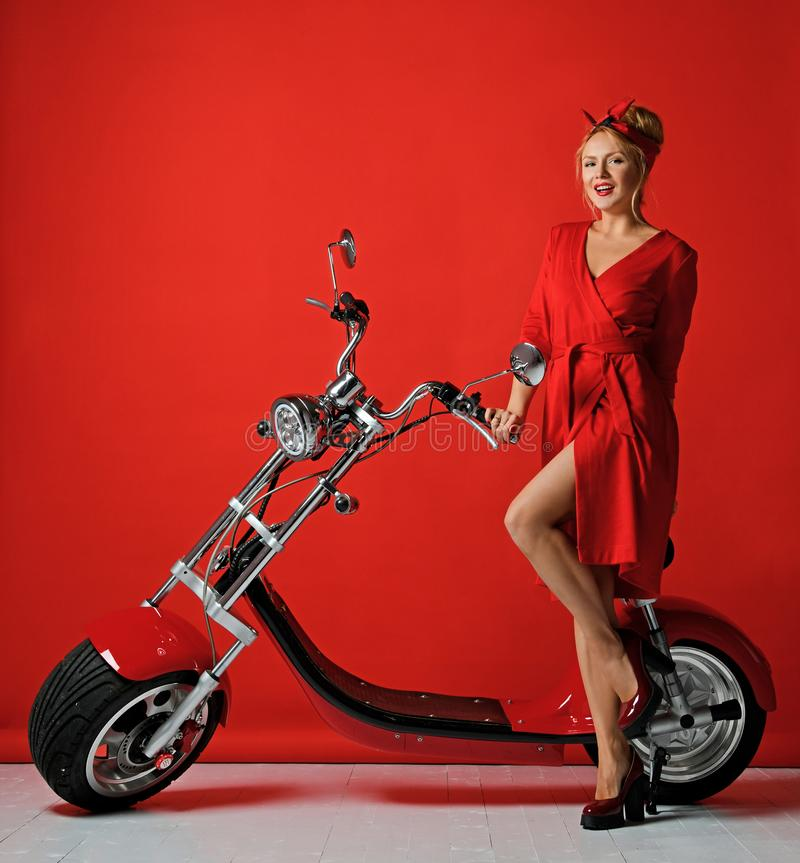 Woman pinup style ride new electric car motorcycle bicycle scooter present for new year 2019 royalty free stock photos