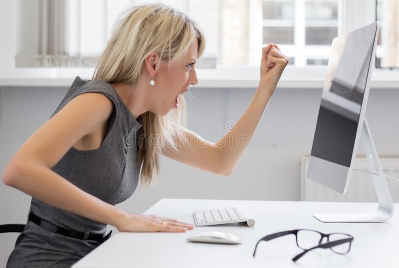 Woman off with her computer. Woman really off with her computer royalty free stock image