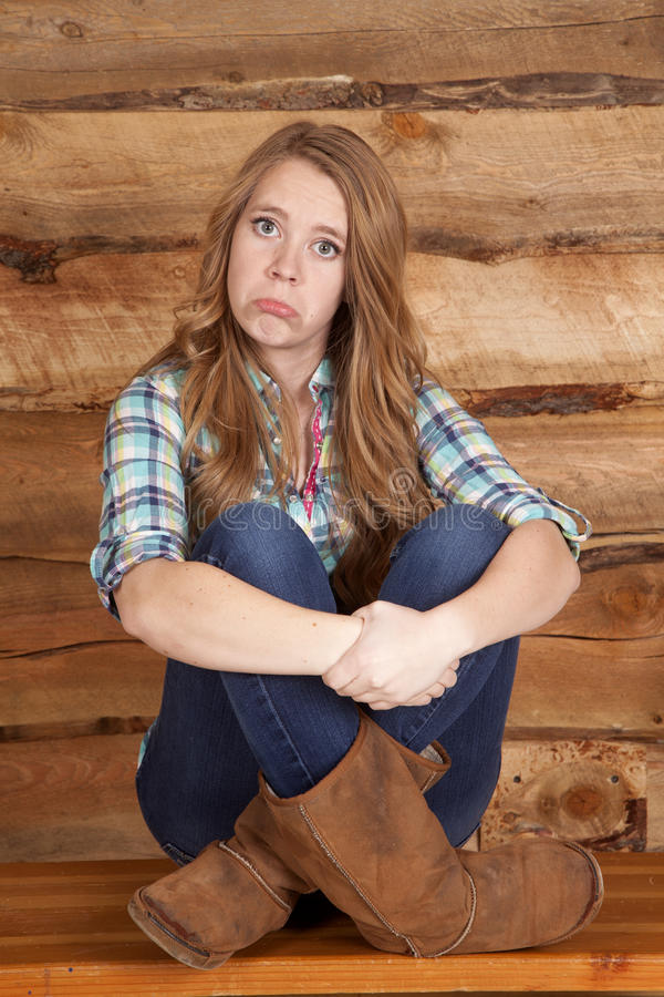 Woman plaid sad wood background stock photography