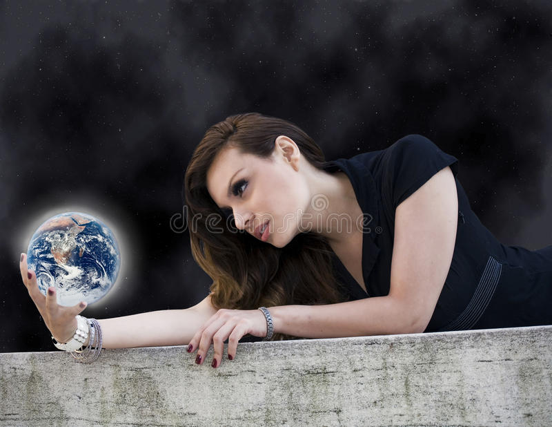 Woman With Planet Royalty Free Stock Photography
