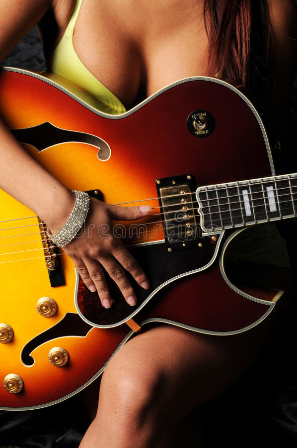 Download Woman planing guitar stock image. Image of music, electric - 19648437