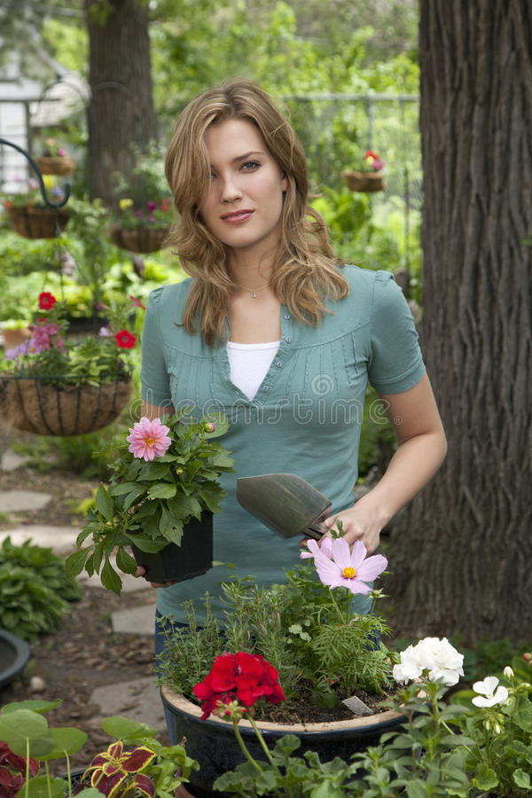 Download Woman Planting Flowers In Her Garden Stock Image - Image: 10575883