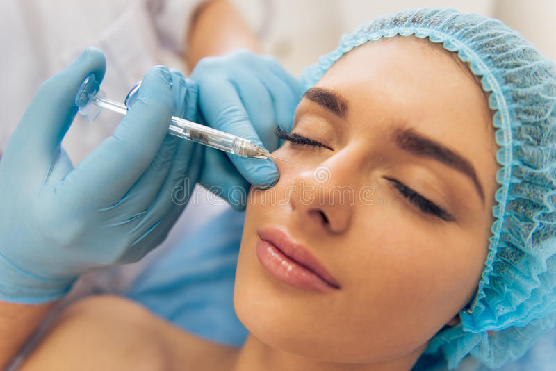 Woman at the plastic surgeon stock photos