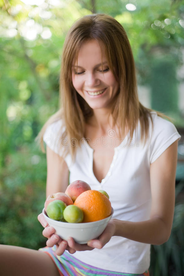 Woman With Plate Of Fruits Royalty Free Stock Photography