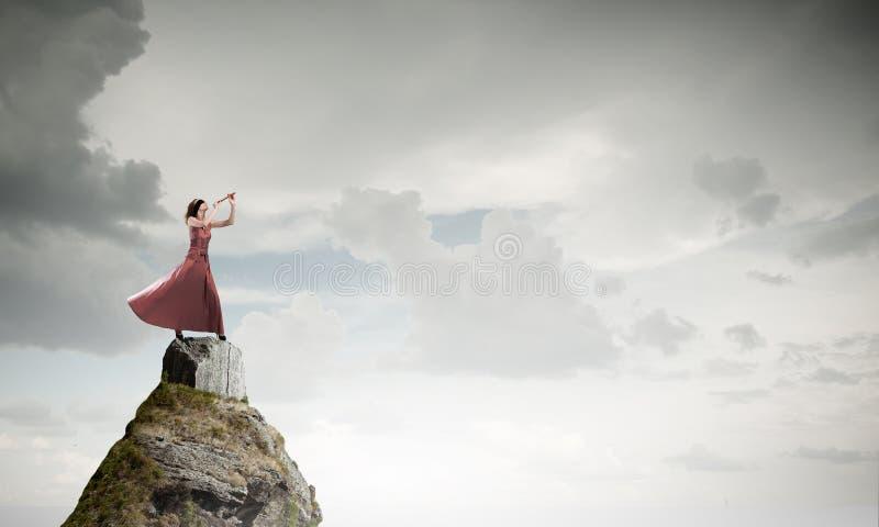 Woman play fife stock photo