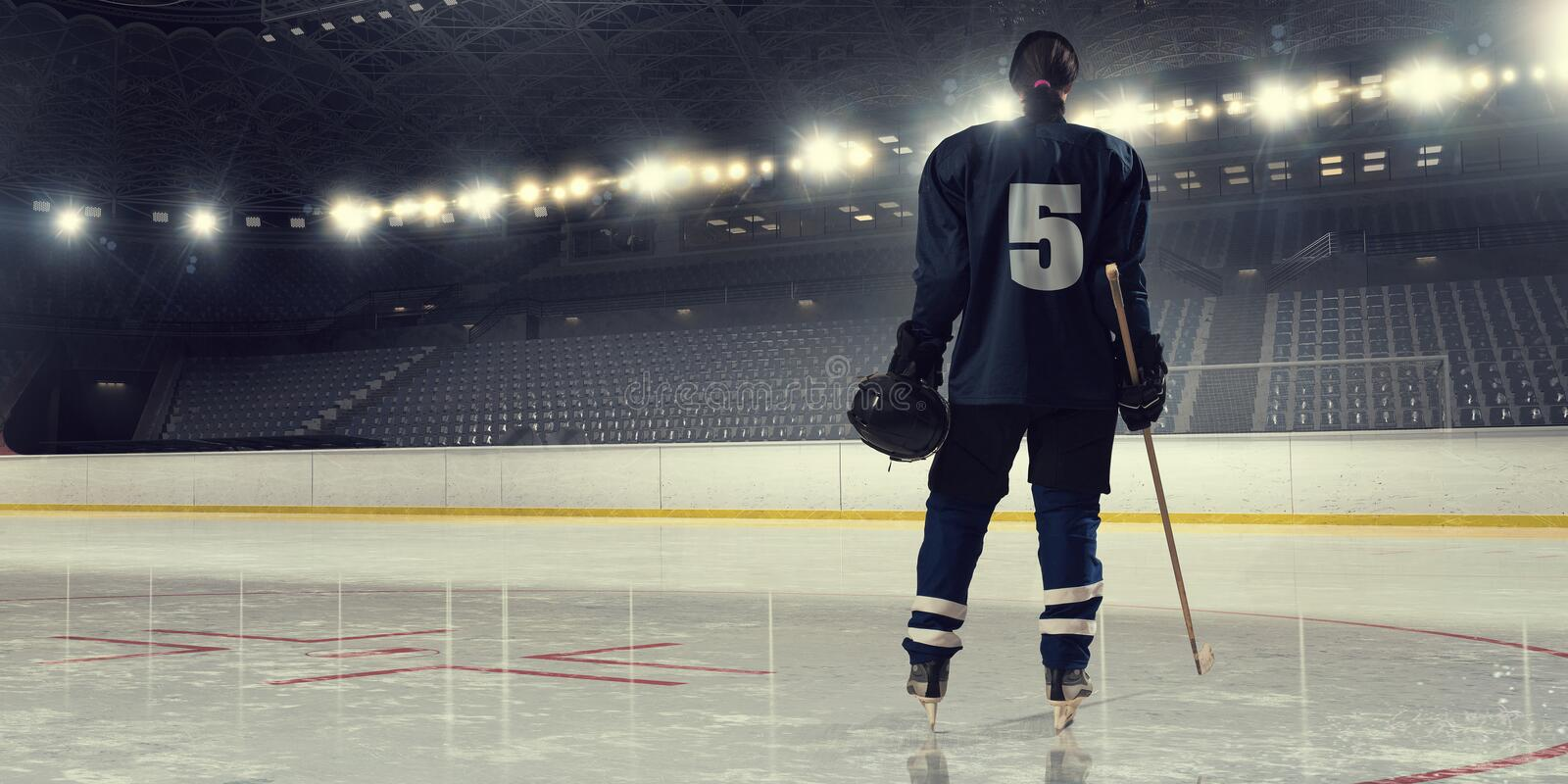 Woman play hockey . Mixed media. Woman ice hockey player during a game stock photo