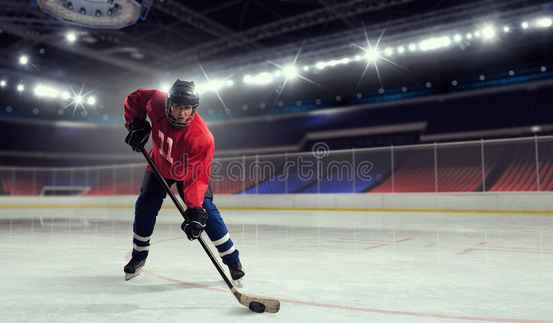 Woman play hockey . Mixed media. Woman ice hockey player during a game stock image