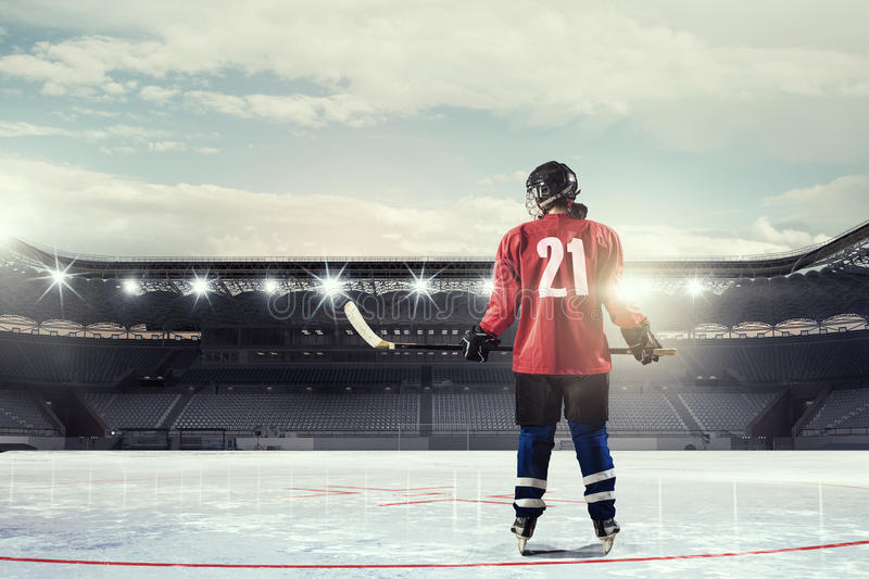 Woman play hockey . Mixed media. Woman ice hockey player during a game royalty free stock images