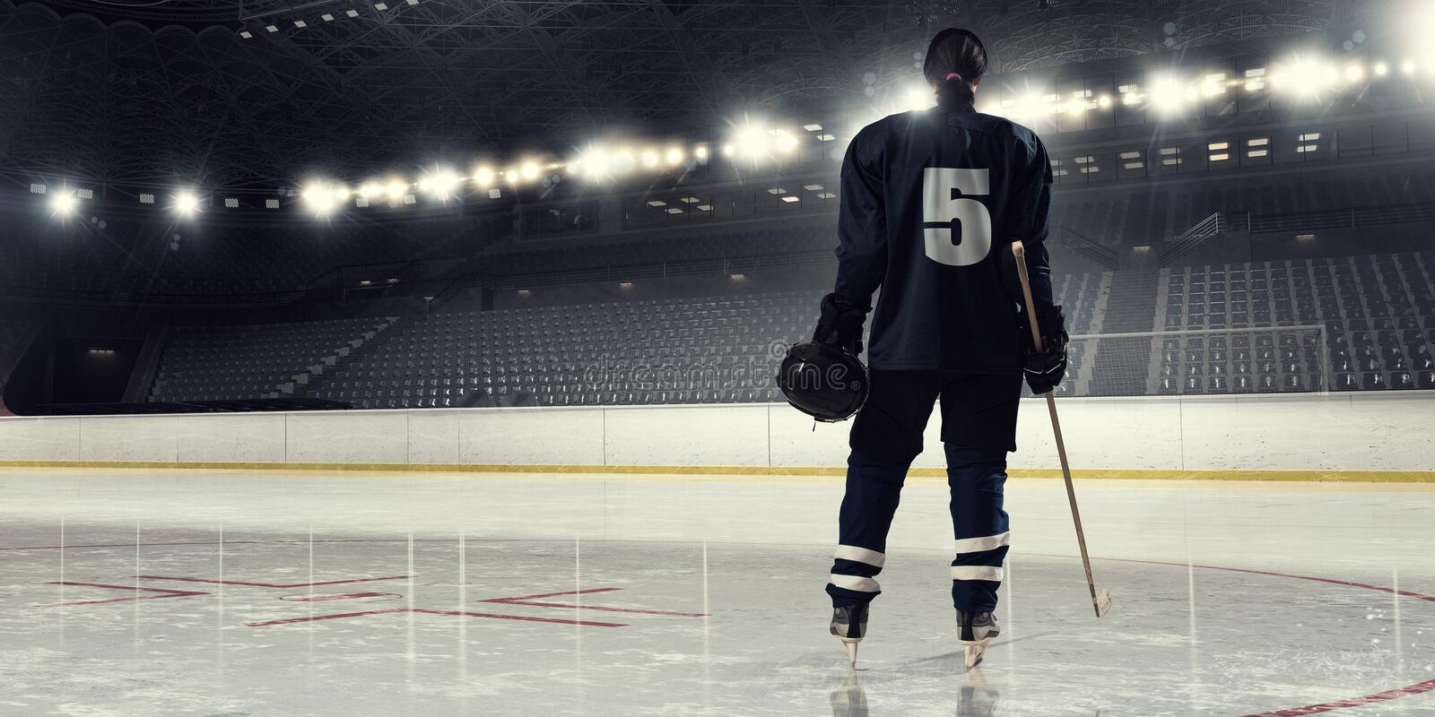 Woman play hockey . Mixed media. Woman ice hockey player during a game royalty free stock photography