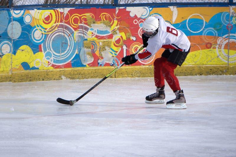 Woman play hockey Mixed media season stick stock photos