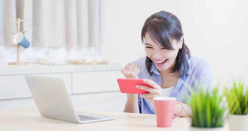 Woman play mobile game stock photography