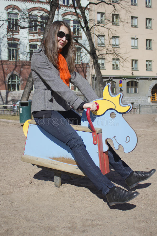 Woman on the playground stock photography