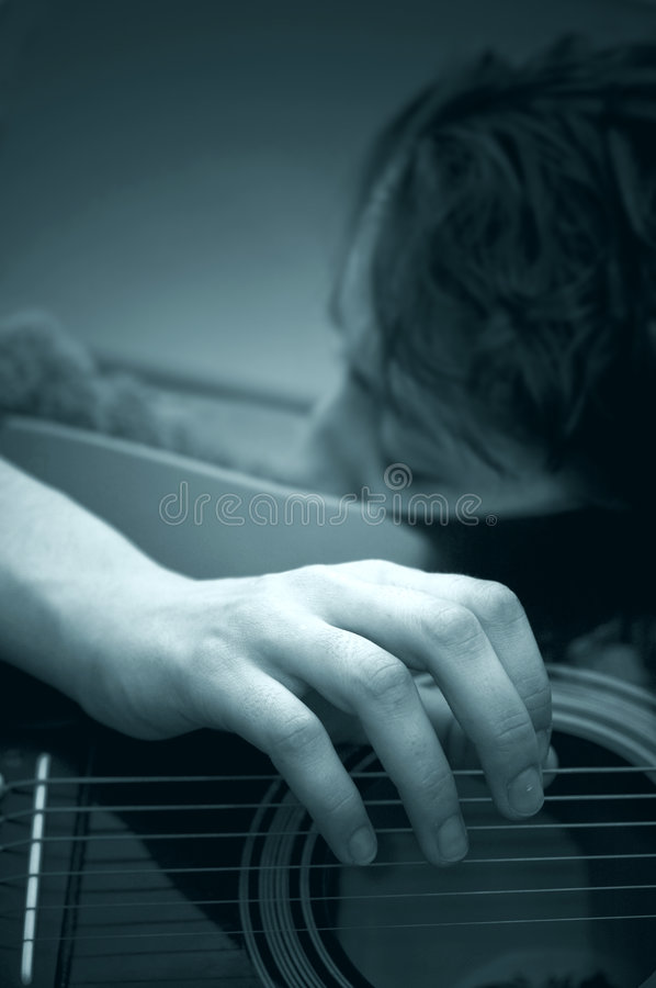 Woman Playing Acoustic Guitar B&W royalty free stock image