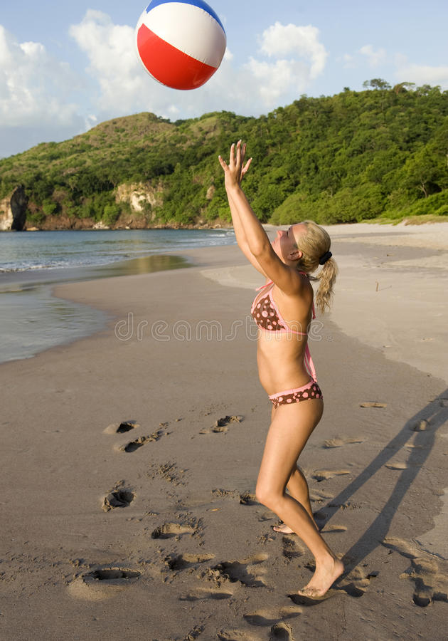 Download Woman Playing Beach Ball Costa Rican Beach Stock Image - Image: 12868113
